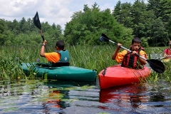 Paddling-on-Frying-Pan-Pond,-Wood-River